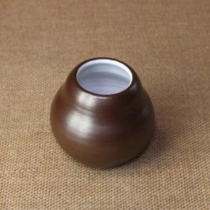 Глиняный калабас ручной работы в виде тыквы.
